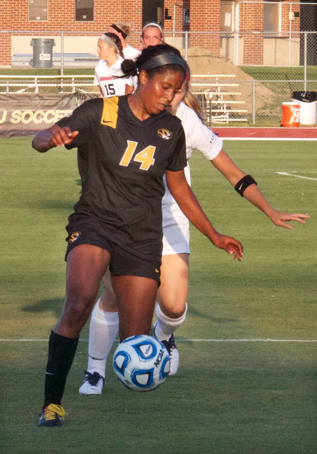 Alyssa Diggs (14) dribbles past a SEMO defender in Friday's game.
