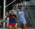 With players around her, goalie Kristen Rivers (15) knocks away a shot.