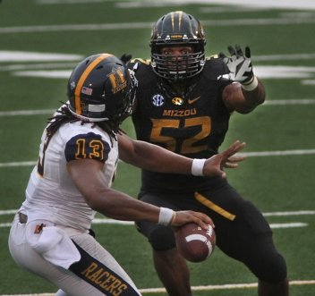 Lineman Michael Sam pressures quarterback Maikhail Miller in the first quarter.