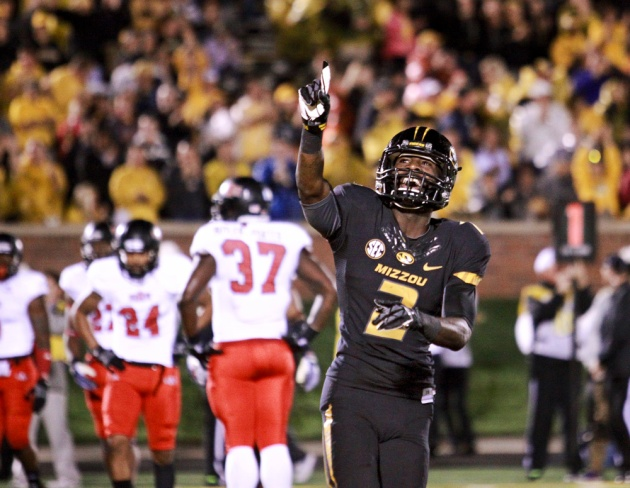 Missouri wide receiver L'Damian Washington celebrates after quarterback James Franklin rushes for a touchdown against Arkansas State. The Tigers rushed for a combined total of 239 yards.