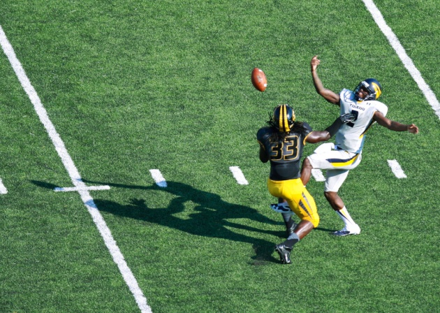 Defensive lineman Markus Golden (33) intercepts the ball from Toledo quarterback Terrance Owens (2). Golden ran the ball back for a touchdown but was penalized for unsportsmanlike conduct while celebrating.