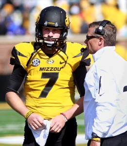 Maty Mauk (7) talks with quarterbacks coach Andy Hill on the sidelines.
