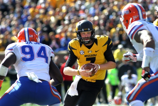 Maty Mauk eyes two defensive players as he moves out of the pocket Saturday against Florida. Mauk was never sacked in the game.