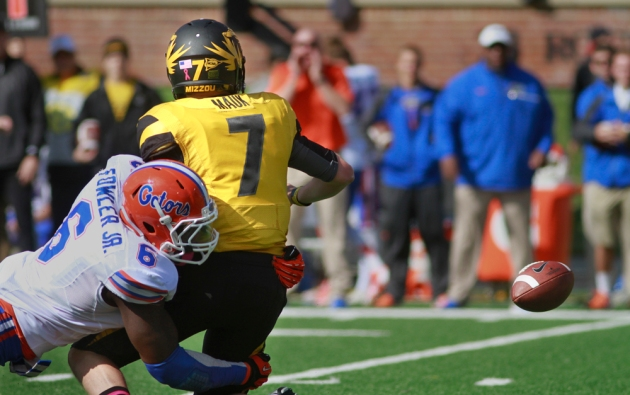 Florida's Dante Fowler Jr. forces Mauk to fumble in the first quarter. Missouri recovered the ball.