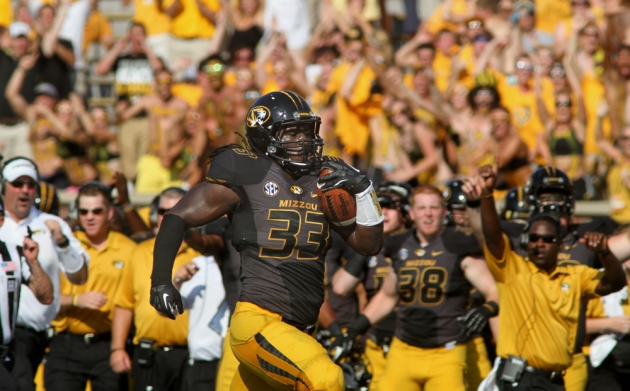 Defensive lineman Markus Golden (33) runs back his interception against Toledo in September, one of 10 interceptions Missouri has this season.