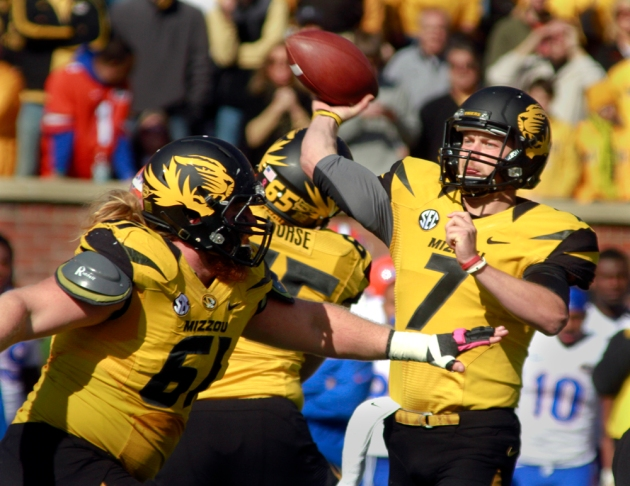 Maty Mauk (7) is protected in the pocket during Missouri's game against Florida on Saturday, Oct. 10, 2013.