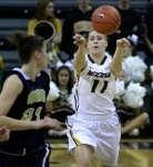 Point guard Lindsay Cunningham (11) passes the ball past Oral Roberts' Bernadett Balla (23).