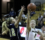 Lianna Doty (1) drives past Christian Key for a layup.