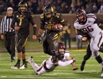 Henry Josey (20) avoids a tackle on his way to the winning touchdown Saturday, Nov. 30, 2013, against Texas A&M in Columbia.