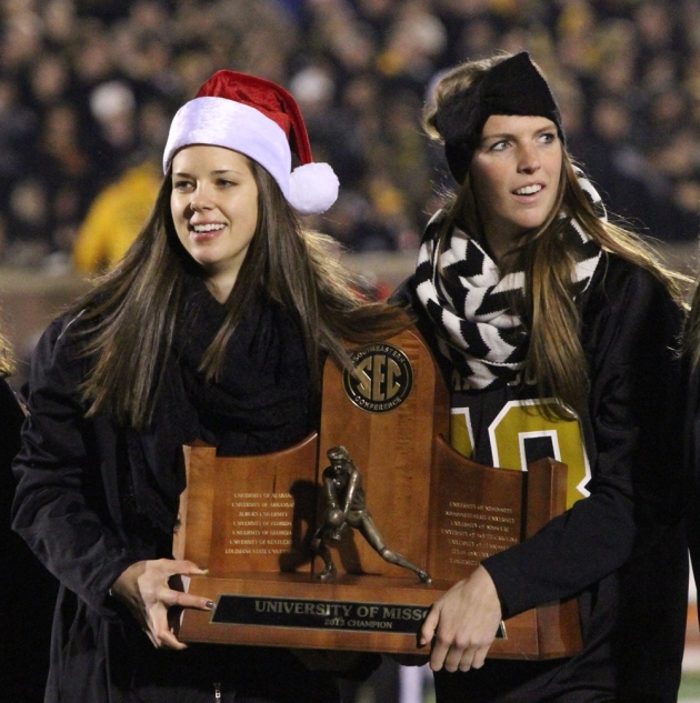 Molly Kreklow and Lisa Henning show off the volleyball team's SEC championship trophy Saturday, Nov. 30, 2013, at the Missouri football game.