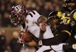 Missouri's Donovan Bonner tackles De'Vante Harris.