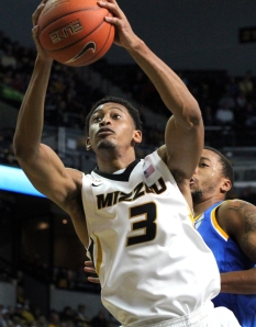 Johnathan Williams III grabs one of his 15 rounds in the game against UCLA on Dec. 7, 2013. Williams also scored 10 points in the game.