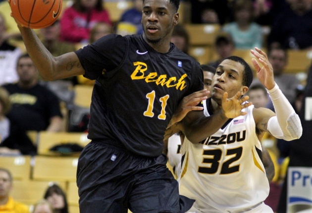 Jabari Brown (32) tries to steal the ball from David Samuels (11) in the second half.
