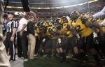 The Missouri Tigers prepare to run onto the field for the Cotton Bowl game.