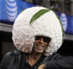 A fan wearing a pod of cotton on his head.