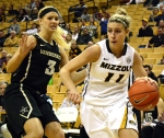 Missouri guard Lindsey Cunningham (11) dribbles the ball toward the basket against Vanderbilt defender Heather Bowe (3) on Thursday, Jan. 30, 2014 at Mizzou Arena. Cunningham scored four points in the Tigers victory over Vanderbilt.