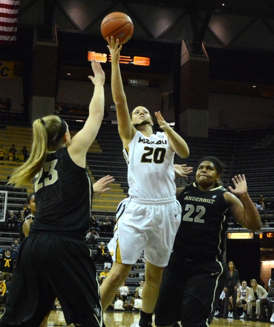 Missouri forward Kayla McDowell (20) beats Vanderbilt defenders MarquÕes Webb (22) and Kylee Smith (23) to the basket for a layup. McDowell had 13 points and eight rebounds off the bench.