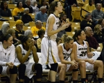 Missouri guard Maddie Stock, standing, watches the Tiger defense in the late minutes of the close conference matchup against the Vanderbilt Commodores.