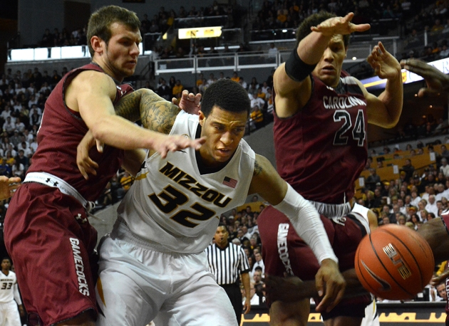 Missouri guard Jabari Brown (32) fights for a loose ball between South Carolina defenders Mindaugas Kacinas (25) and Michael Carrera (24) on Saturday, Jan. 25, 2014 at Mizzou Arena. Brown led the Tigers in scoring with 24 points. Photo by Cody Mroczka.
