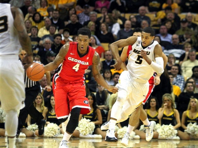 Georgia's Charles Mann (4) leads a fast break with Missouri's Jordan Clarkson (5) in pursuit. Missouri chased Georgia all night, losing in overtime 70-64. Photo by Karen Mitchell.