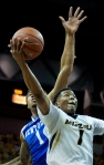 Missouri's Wes Clark goes in for a layup against Kentucky's James Young.