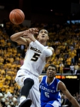Jordan Clarkson loses the ball as Andrew Harrison looks on. Missouri had trouble with ball control in the first half.