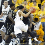 Missouri guard Jordan Clarkson (5) drives to the basket while Missouri forward Ryan Rosburg (44) looks on. Clarkson led the Tigers with 21 points, adding five rebounds and five assists.