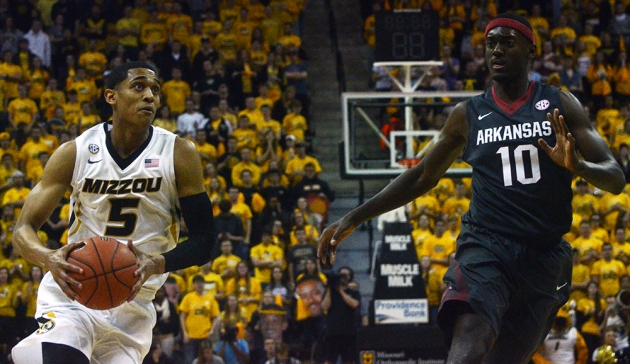 Missouri guard Jordan Clarkson (5) drives past Arkansas defender Bobby Portis (10). Clarkson led the Tigers with 27 points and four assists.