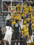 Missouri guard Jordan Clarkson (5) drives past Arkansas defenders Bobby Portis (10) and Rashad Madden (00) for a layup. Clarkson finished with more than 20 points for the 13th time this season.