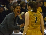 Missouri coach Robin Pingeton and sophomore Lianna Doty (1) go over the game plan during a free throw attempt in Missouri's win over Ole Miss. Doty fouled out of the game with 1:31 remaining and was replaced by freshman Lindsey Cunningham.