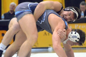 Missouri's John Eblen (top) attempts to take down Old Dominion's Jack Dechow during the 184-pound match at the Hearnes Center on Feb. 16, 2014. Eblen would go on to win his match, 7-5.