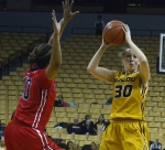 Missouri junior guard Morgan Eye (30) looks to pass in the team's 75-72 win against the Ole Miss Rebels. Eye jump-started the Tigers in the second half, hitting five consecutive 3-pointers.