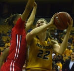 Missouri freshman Jordan Frericks (22) goes up for a shot against an Ole Miss defender. Frericks hit four free throws in the final 1:17 to help the Tigers pull away from Ole Miss.