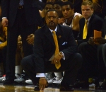 Missouri coach Frank Haith crouches to get a better view of the action against Arkansas. Haith and the Tigers improved to 17-7 overall and 5-6 in the Southeastern Conference following the win.