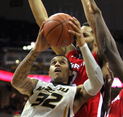 Jabari Brown leans against defenders as he drives to the basket against Georgia in this January 2014 photo.