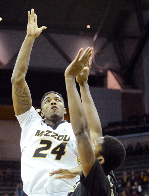 Missouri forward Torren Jones (24) attempts a shot over a Vanderbilt defender. Jones finished the game with four points, four rebounds and three steals in 18 minutes of action for the Tigers.