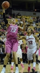 Missouri forward Bri Kulas (13) beats Alabama defender Shafontaye Myers (12) to the basket for a layup. Kulas finished the game with 18 points for the Tigers.