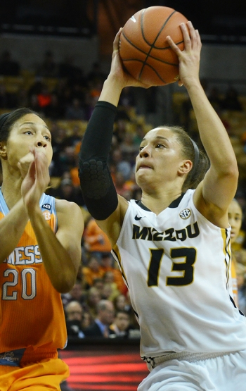 Senior Bri Kulas (13) drives past Isabelle Harrison (20) for a layup. Kulas had 22 points and six rebounds in the loss to Tennessee.