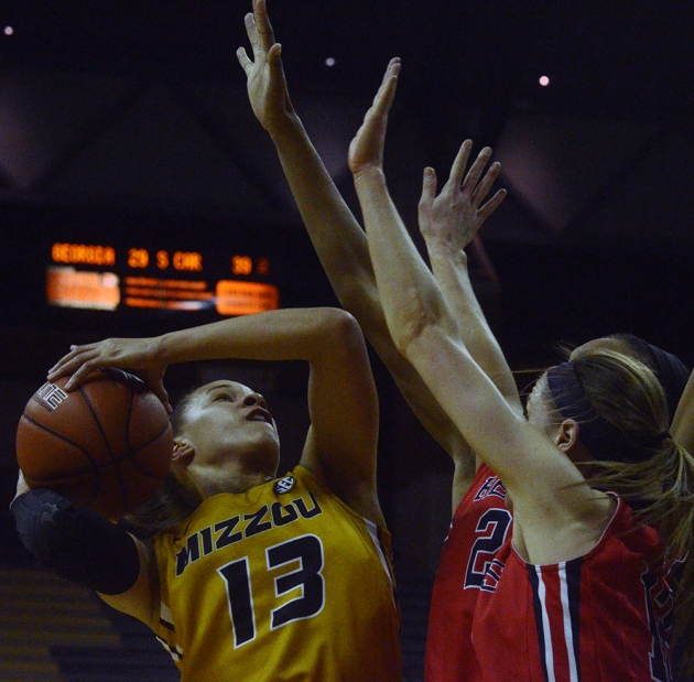 Missouri senior forward Bri Kulas (13) attempts a shot against two Ole Miss defenders. Kulis led all scorers with 26 points in the game.