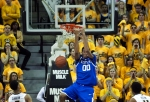 Fans in the student section watch as Kentucky's Marcus Lee scores his only points of the game on this dunk.