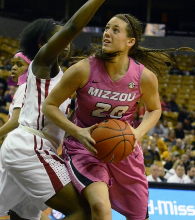 Missouri forward Kayla McDowell (20) makes her way to the basket against an Alabama defender. The freshman had 12 points and 11 rebounds coming off the bench.