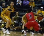 Missouri senior forward Bri Kulas (13) attempts to contain Ole Miss guard Valencia McFarland (3). McFarland led the Rebels with 19 points and five assists.