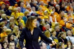 Against a background of Tiger and Volunteer fans, Missouri coach Robin Pingeton yells to her offense in the second half. The 5,017 fans at Mizzou Arena marked the seventh best attendance in the history of the Missouri women's basketball program.