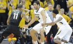 Missouri forward Keanau Post (45) and guard Wes Clark (1) attempt to defend Vanderbilt guard Kyle Fuller (11). Fuller was held to six points after scoring 22 in the first game against Missouri earlier this season.