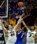 Ryan Rosburg (44) and Jonathan Williams (3) try to block the shot of James Young (1) in the second half.