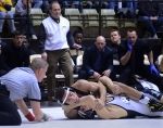 Missouri coach Brian Smith (white vest) looks on as Joey Lavallee (black) wrestles Brandon Zeerip on Feb. 8, 2014 at the Hearnes Center. Lavallee won the match 3-1.