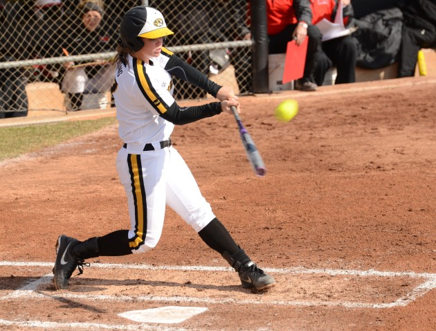Third base Natalie Fleming hits a home run to left field in game two of the doubleheader Wednesday, March 19, 2014. She was 2-3 with 1 RBI on the day.