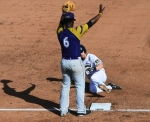 Alcorn State's Shaquille Cockrell signals to hold the throw as Zach Lavy slides into third base.