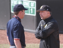 Missouri coach Ehren Earleywine, right, talks with first base umpire Cory Hastings about a call he made.