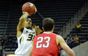 Missouri guard Jabari Brown attempts a jump shot over Davidson defender Tom Droney on Tuesday, March 18, at Mizzou Arena. Brown led the Tigers in scoring with 30 points.